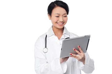 Young female doctor holding a tablet
