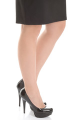 Business woman's legs and black high heels.
