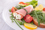 vegetable salad and ham rolled with cheese