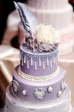 Purple wedding cake decorated with flowers