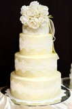 White wedding cake decorated with white lace