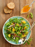 Salad with oranges, arugula, walnuts with vinaigrette.