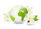 Earth globe with white flowers