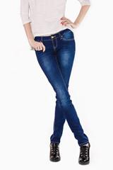 Shapely female legs dressed in dark blue jeans