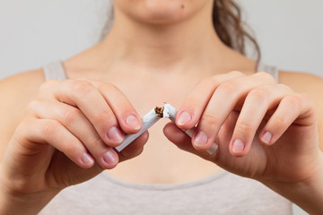 woman breaking a cigarette, quit smoking concept,
