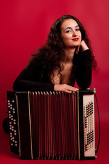 brunette in an elegant dress with accordion