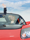 Woman waves of her hand for driving enjoyment