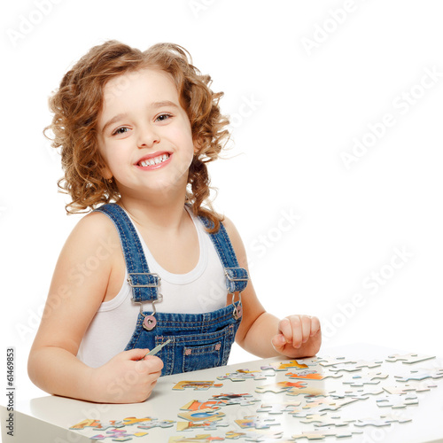 Little baby playing in the puzzle.