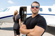 Bodyguard Standing Against Woman And Private Jet - 61470449