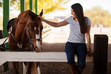 Petting my horse at a ranch