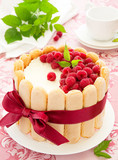 "Cake ""Charlotte"" with raspberries and cream, selective focus."