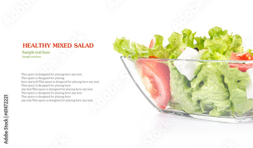 Fresh salad in glass bowl with space for your text
