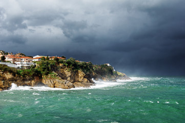 lekeitio coastline with storm and rough sea
