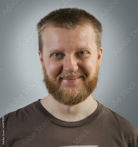 Cheerful, bearded man