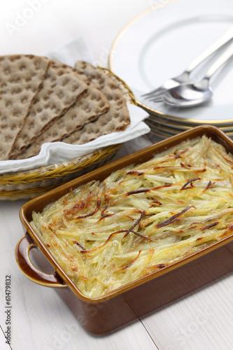 Janssons frestelse, Swedish potato gratin with sprat fillets - 61479832