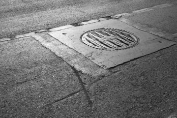manhole on the street with sunshine