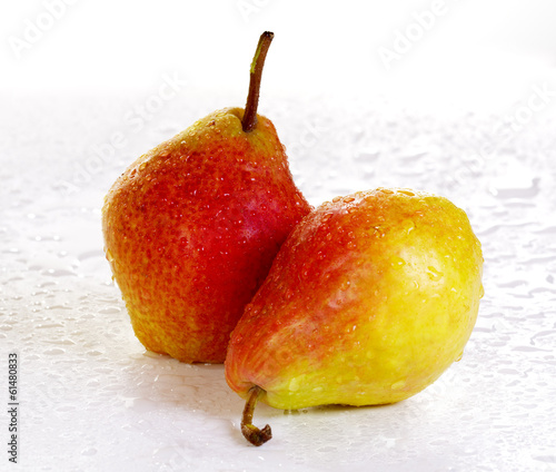 Two yellow-red pears on a white background