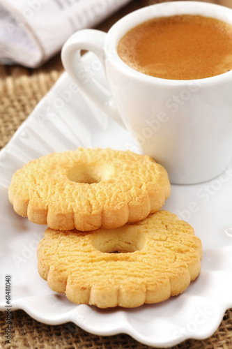 Morning cup of strong espresso coffee with butter cookies