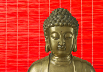 Golden Buddha is on the red background