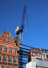 Construction crane with old and new buildings