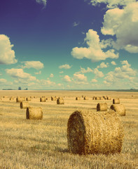 bales of straw in field - vintage retro style