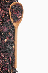 Wooden spoon with dried hibiscus
