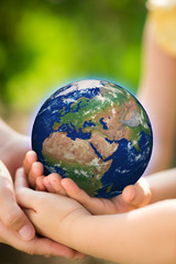 Children holding Earth in hands