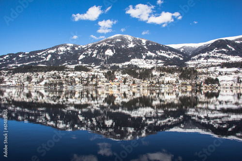 Lake Millstatt, City Mountain Blue Sky Reflection In Winter