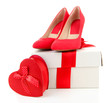 Beautiful red female shoes and gift box, isolated on white