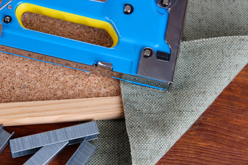 Construction stapler with staples and cork board