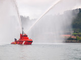 Salvage tugboat with two big water jets.