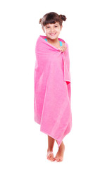 Girl in a swimsuit wrapped in a pink towel