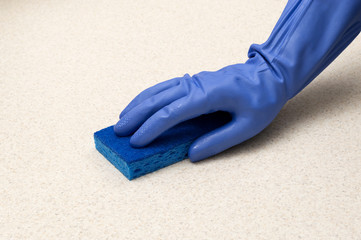 Hand In Rubber Glove With Sponge