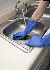 Woman Doing Chores Scrubbing Kitchen Sink