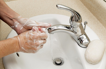 Woman Washing Hands With Bar Soap