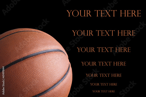 Orange basketball on dark background with space for text