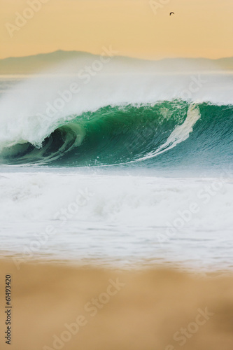 Fotobehang Caraïben Ocean Wave at Sunset