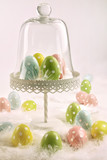 Cake stand with easter eggs and feathers