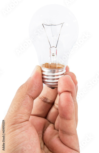 A male hand holding a light bulb over white background