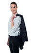 Businesswoman with coat slung over her shoulder