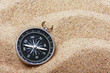 compass on the hot sand - 61495495