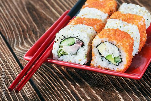 seafood sushi and chopsticks - 61495489