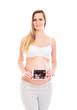 A pregnant blond woman holding an ultrasound