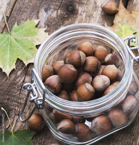 fruits nutmeg, in glass container on the wooden table