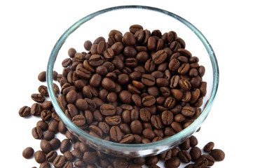 Coffee beans around glass jug
