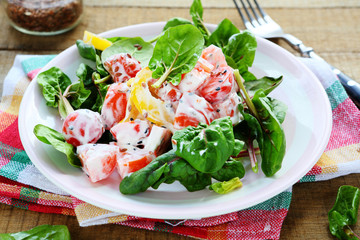 fresh salad with tomatoes, peppers and yogurt