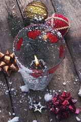 decorations for the Christmas tree and a burning candle