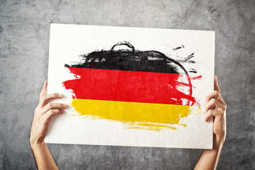 Germany flag. Man holding banner with german Flag.