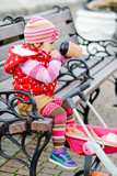 cute baby on the walk with toy stroller