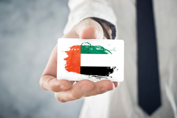 Businessman holding business card with United Arab Emirates Flag